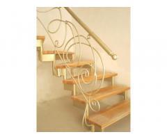 Изготовление металлических каркасов лестниц с обшивкой деревом